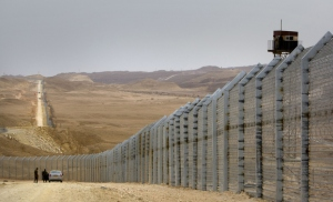 Egyptian border guards (R) observe from