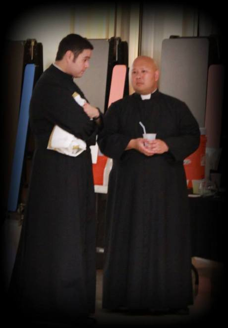 young Fathers in cassocks