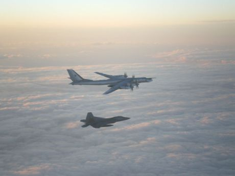 F-22 escorts Tu-95MS Bear