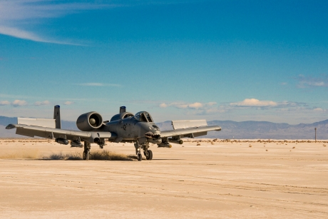 A-10 has split flaps that open nearly 90 deg to act like enormous dive breaks.  Work great for landing.
