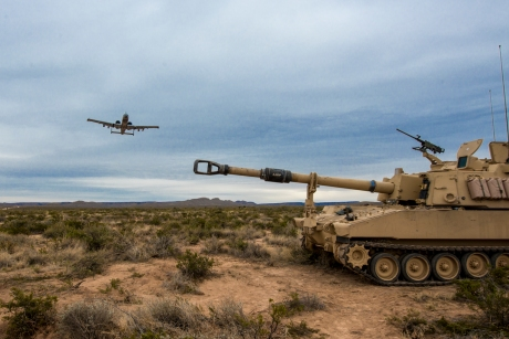 """A-10 overflying M106A6 """"Paladin"""" self-propelled 155mm gun. Both types are nearly 50 years old."""