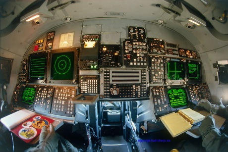 Back end of B-1B; crew stations for Offensive and Defensive Systems Operators.  All monochrome CRT displays.  Large box in middle is the Integrated test system, an automatic fault-reporting device