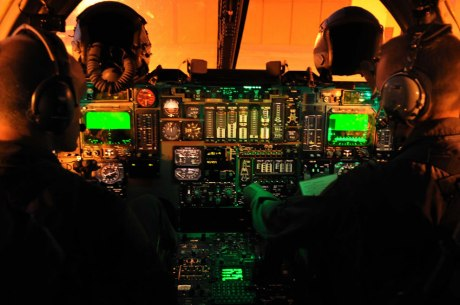 Night photo also taken at Dyess unupgraded B-1B. Note single multi-function CRT display for each pilot. All other instruments are analog, mostly very effective vertical tape indicators