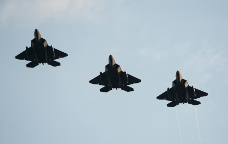 Three F-22 Raptor fighter aircraft fly over Spangdahlem Air Base, Germany, Aug. 28, 2015 as part of the inaugural F-22 training deployment to Europe. Four F-22s from the 95th Fighter Squadron at Tyndall Air Force Base, Fla., along with a C-17 Globemaster III cargo aircraft and more than 50 support Airmen were part of the deployment. This effort is part of the European Reassurance Initiative and will serve to assure allies of the Air Force's commitment to European security and stability. (U.S. Air Force photo by Staff Sgt. Chad Warren/Released)