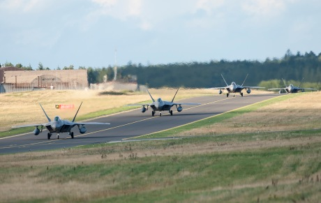 Four F-22 Raptor fighter aircraft taxi after landing at Spangdahlem Air Base, Germany, Aug. 28, 2015 as part of the inaugural F-22 training deployment to Europe. The F-22s are deployed from the 95th Fighter Squadron at Tyndall Air Force Base, Fla., as part of the European Reassurance Initiative and will conduct air training with other Europe-based aircraft while demonstrating U.S. commitment to NATO allies and the security of Europe. (U.S. Air Force photo by Staff Sgt. Chad Warren/Released)