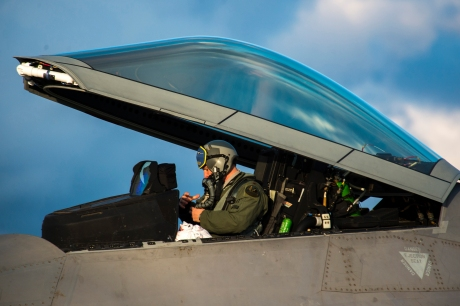 An F-22 Raptor fighter aircraft pilot assigned to the 95th Fighter Squadron at Tyndall Air Force Base, Fla., prepares to exit an F-22 at Spangdahlem Air Base, Germany, Aug. 28, 2015. The U.S. Air Force deployed four F-22 Raptors, one C-17 Globemaster III and more than 50 Airmen to Spangdahlem in support of the first F-22 European training deployment. The inaugural F-22 training deployment to Europe is funded by the European Reassurance Initiative, a $1 billion pledge announced by President Obama in March 2014.(U.S. Air Force photo by Airman 1st Class Luke Kitterman/Released)