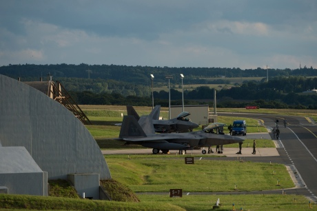 Members of the 95th Fighter Squadron from Tyndall Air Force Base, Fla.,marshal U.S. Air Force F-22 Raptor fighter aircrafts near hardened aircraft shelters,Aug. 28, 2015, on Spangdahlem Air Base, Germany. The 95th FS deployed to Spangdahlem as part of the European Reassurance Initiative, which is intended to increase the capability, readiness and responsiveness of NATO forces in part by funding rotational force presence in Eastern Europe. This training deployment is also part of ensuring the 5th generation fighters can deploy to European bases and other NATO installations. (U.S. Air Force photo by Staff Sgt. Christopher Ruano/Released)