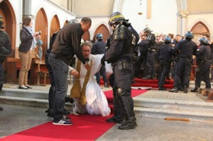 Dragging Priest Away