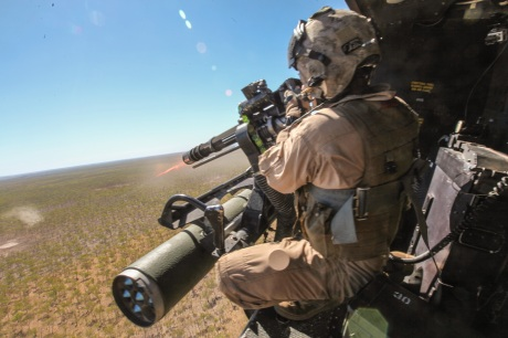 Sergeant Brian D. Richardson, a 29-year-old crew chief for Marine Medium Tiltrotor Squadron 265 (Reinforced), 31st Marine Expeditionary Unit, and a native of Leesburg, Fla., fires a 7.62mm GAU-17/A weapon system at enemy targets from a UH-1Y Venom helicopter during live-fire training as part of Exercise Koolendong 13 here, Sept. 2. Three Venom helicopters and four MV-22 Osprey aircraft are operating from an expeditionary airfield 300 miles inland, supporting the battalion-sized element conducting the exercise. Koolendong demonstrates the operational reach of the 31st MEU and why it is the force of choice for the Asia-Pacific region. Also participating in the exercise is the Marine Rotational Force - Darwin and soldiers of the 5th Royal Australian Army. The 31st MEU brings what it needs to sustain itself to accomplish the mission or to pave the way for follow-on forces. The size and composition of the 31st MEU makes it well suited for amphibious operations, which includes raids, assaults, evacuations and humanitarian assistance operations.
